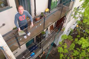 Michael outside his flat with the loose concrete